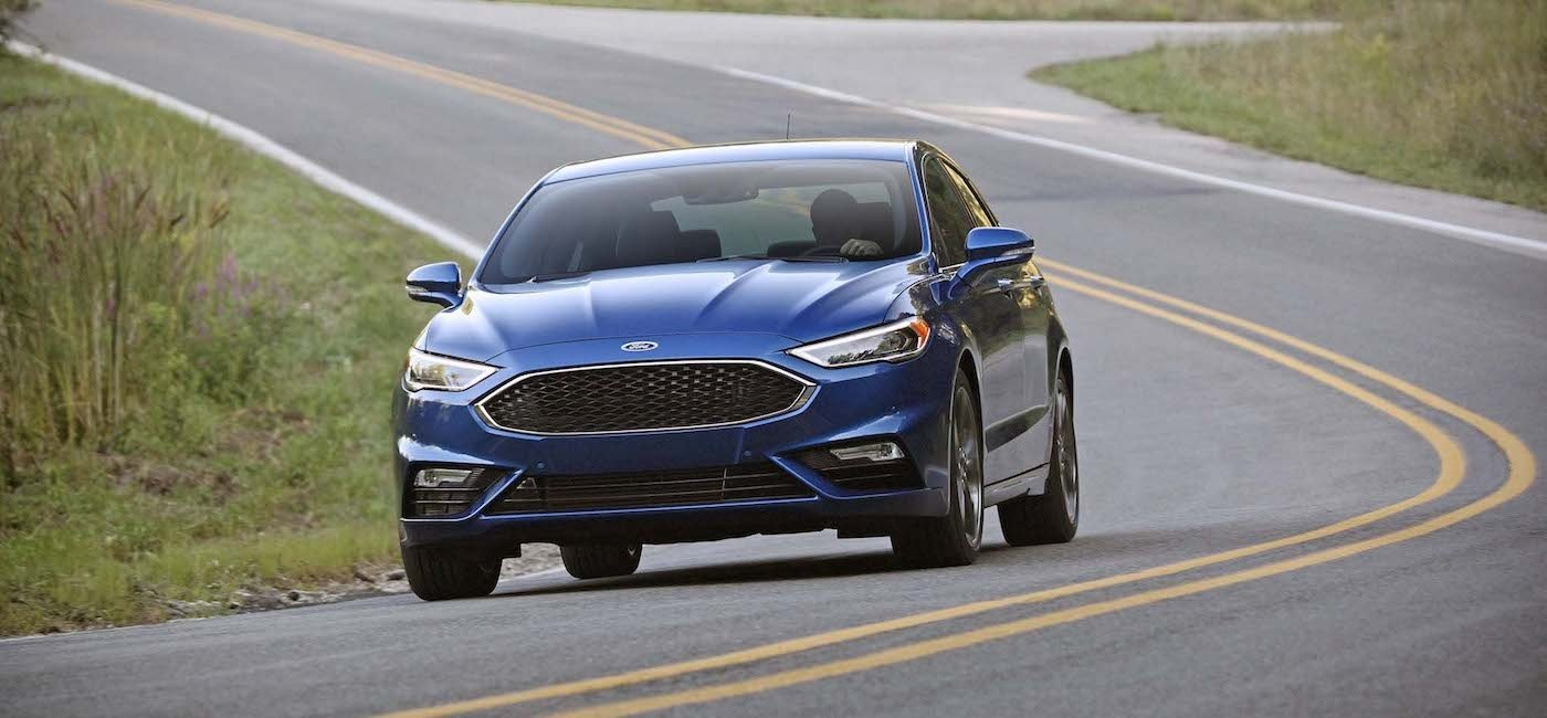 Blue Used Ford Fusion Sport from the front on a grassy road