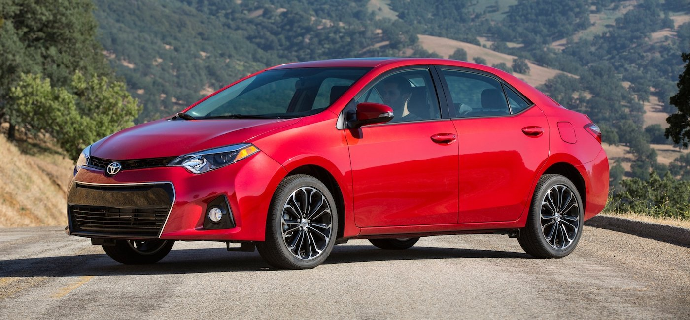 2014 Red Used Toyota Corolla on mountain road