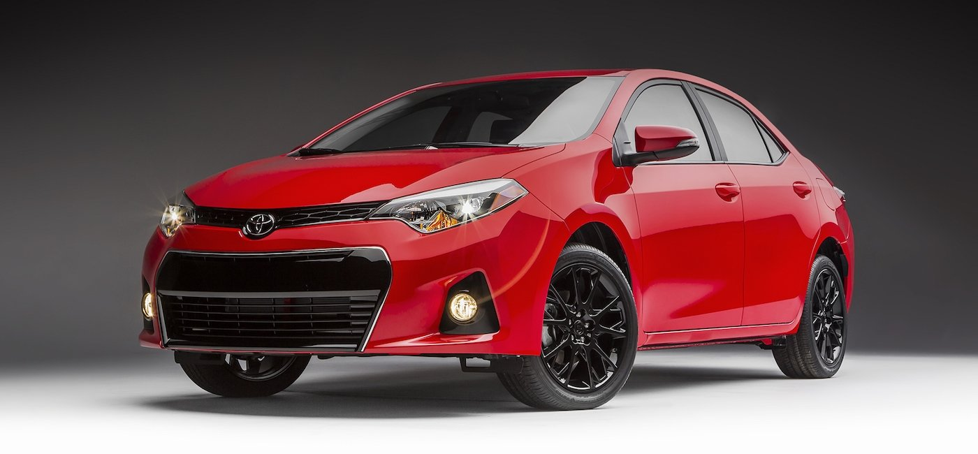 Red 2016 Used Toyota Corolla angled left on gray background
