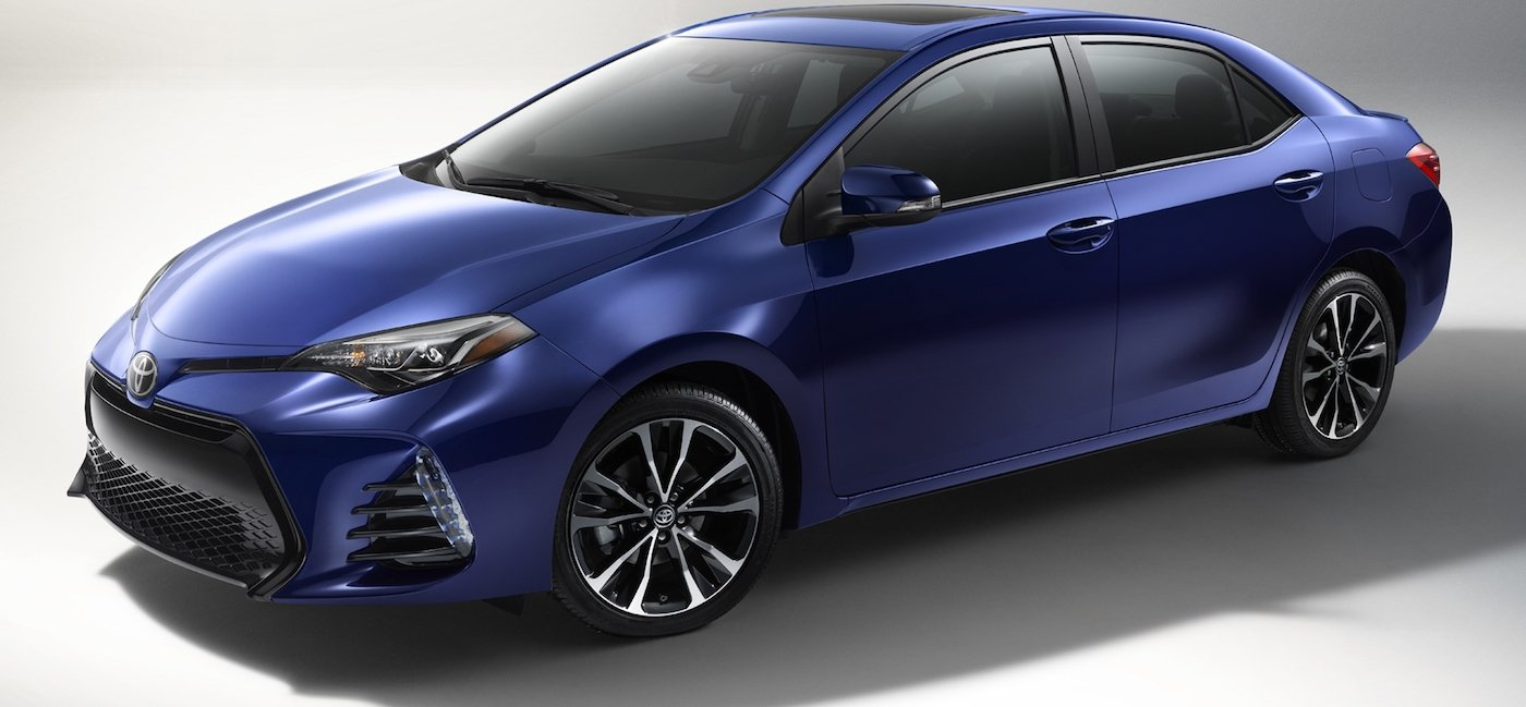 Used dark Blue 2017 Toyota Corolla angled left on white