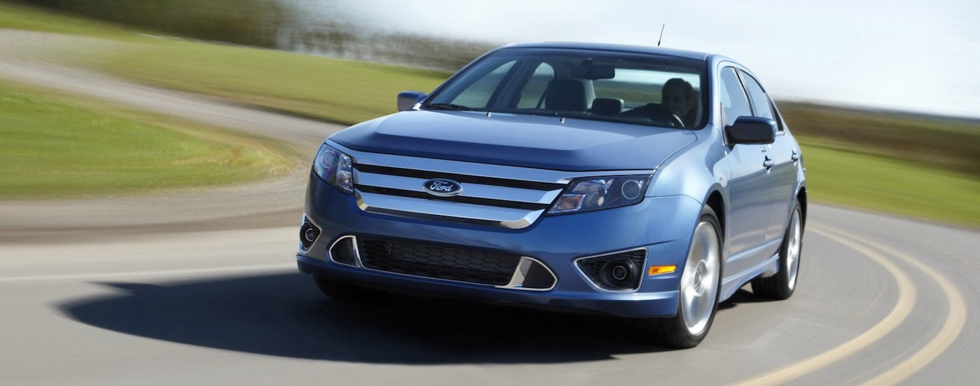 Blue 2010 Used Ford Fusion from the front driving around the test track