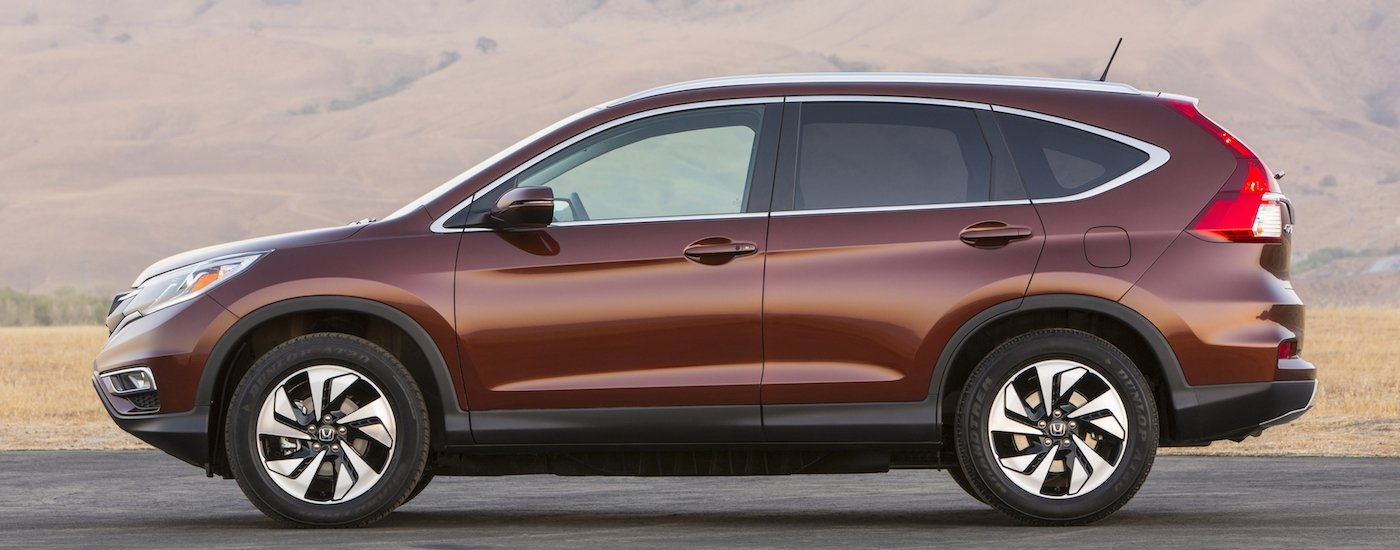 Profile of a Red 2016 Used Honda CR-V parked in the desert