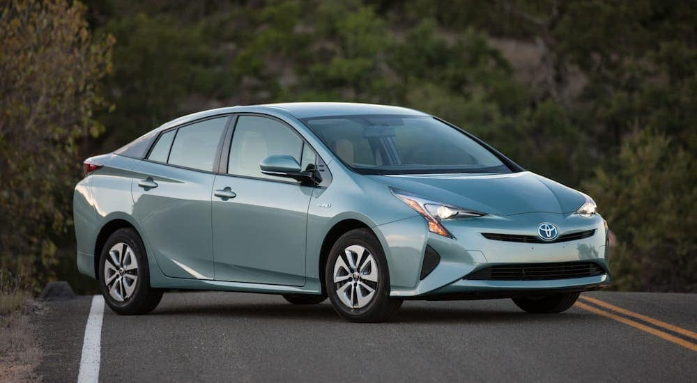 A blue 2016 Toyota Prius Three is parked on a road outside Cincinnati, OH.