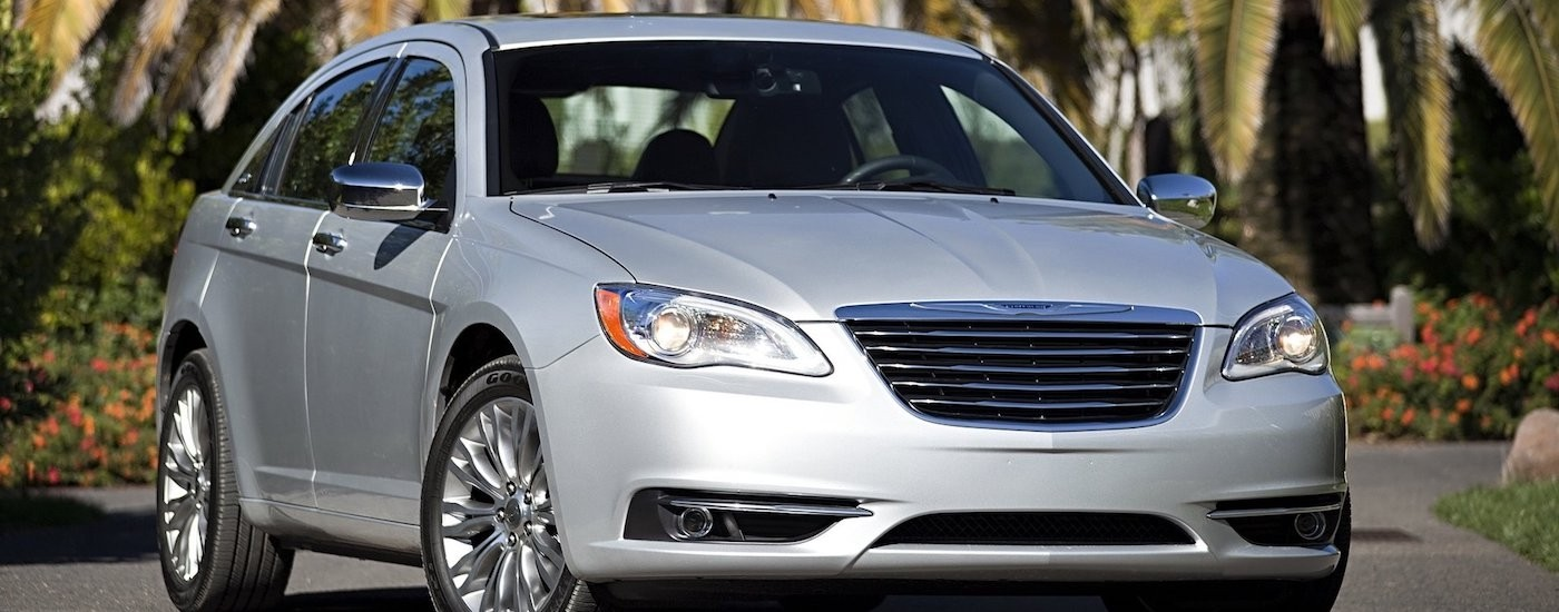 Silver 1st Generation Used Chrysler 200 in front of palm trees