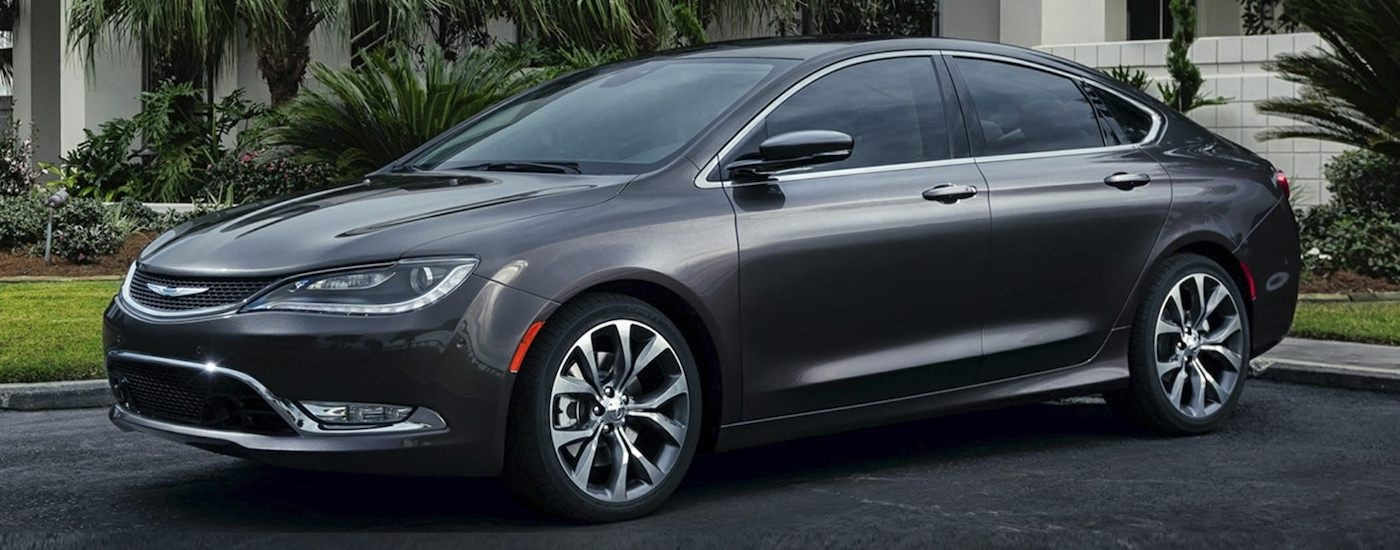 Gray 2nd Generation Used Chrysler 200 in front of a white home