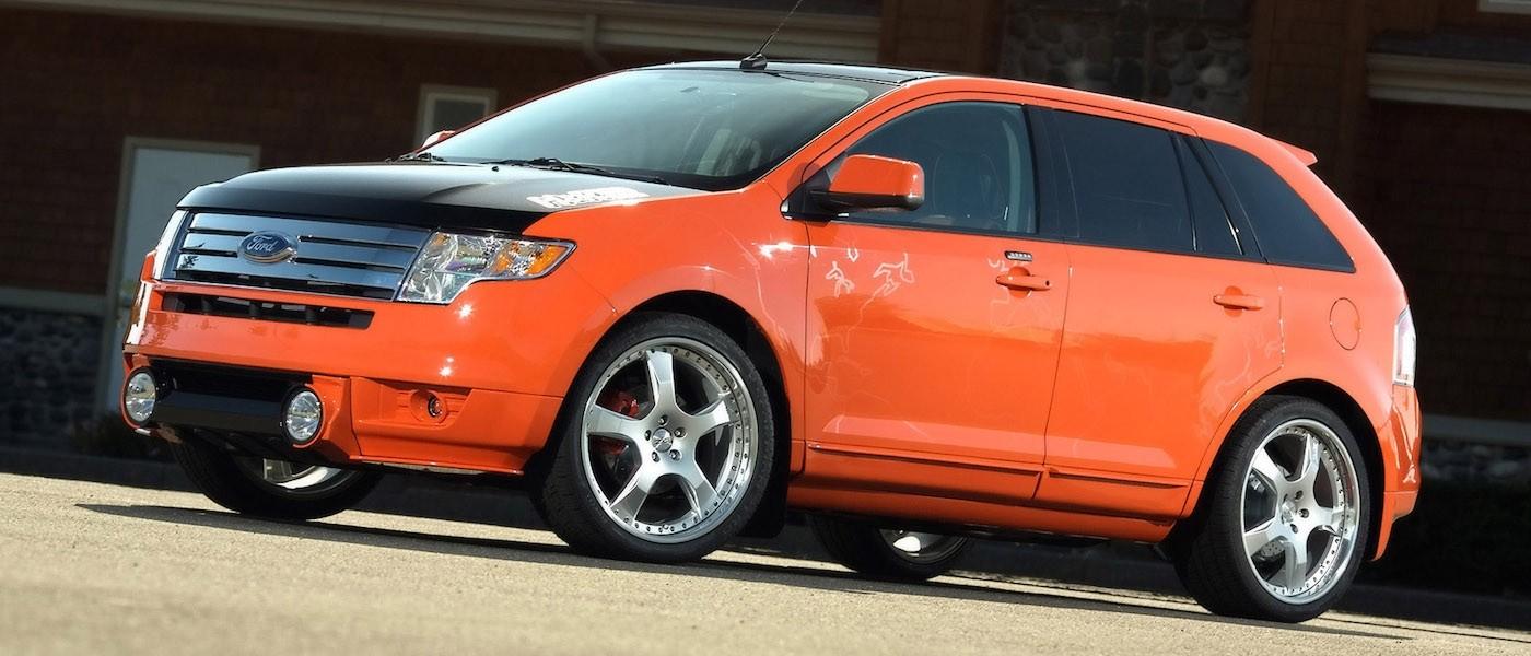 Customized Orange 2007 Used Ford Edge with black hood