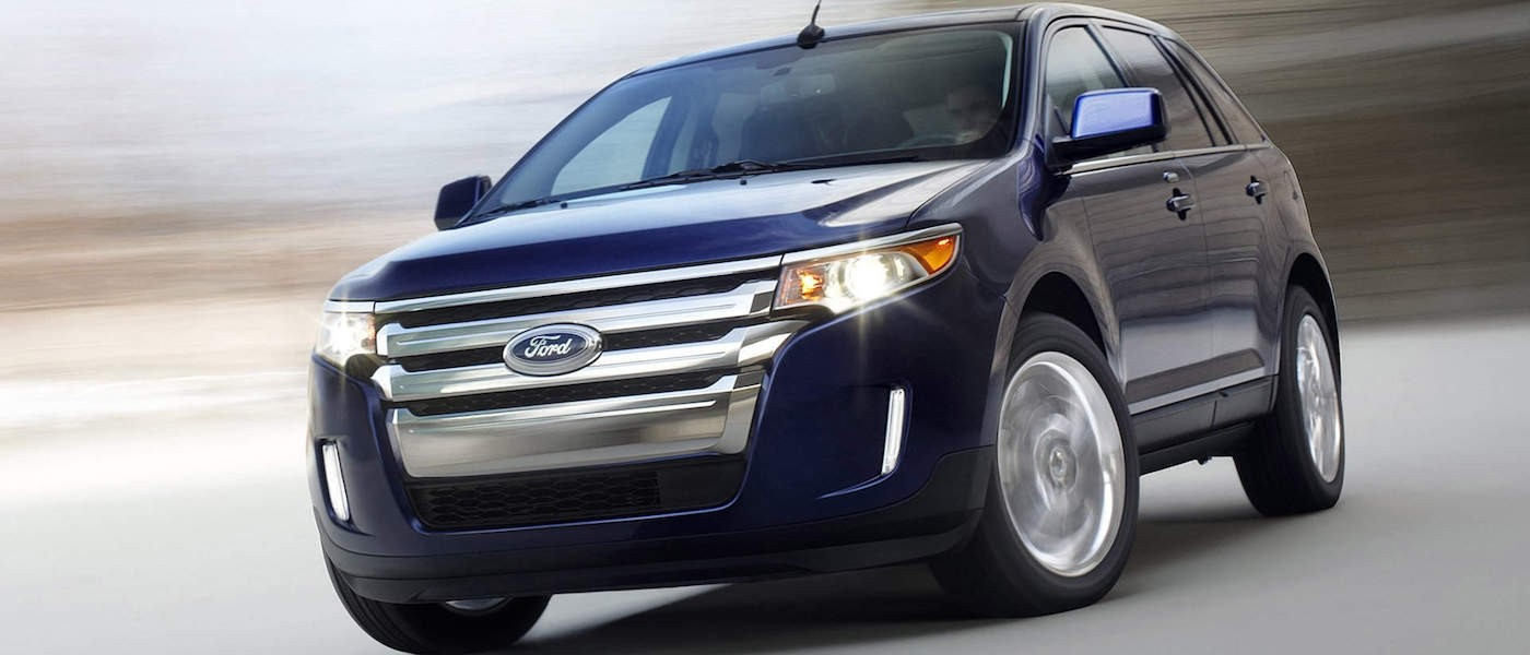 Blue 2011 Used Ford Edge from the front against a blurry background