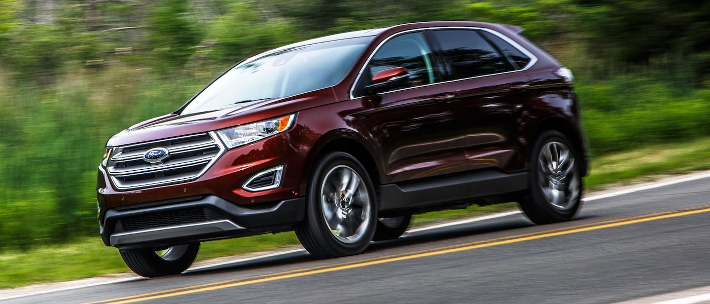 Dark Red 2015 Used Ford Edge driving on a grassy road