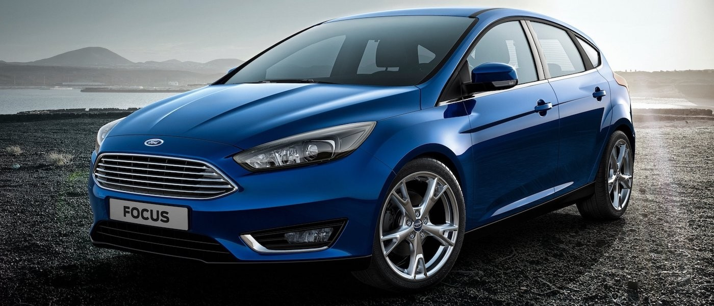 Blue 2015 Used Ford Focus parked next to lake