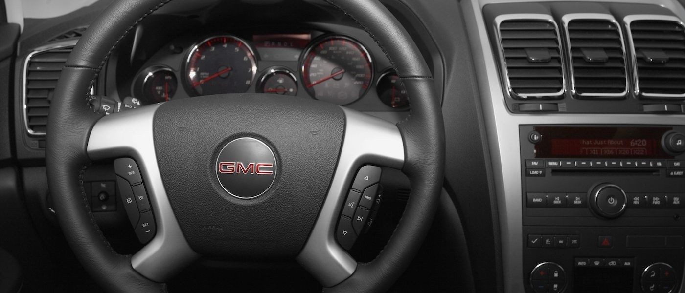 Closeup of the steering wheel in a 2010 Used GMC Acadia