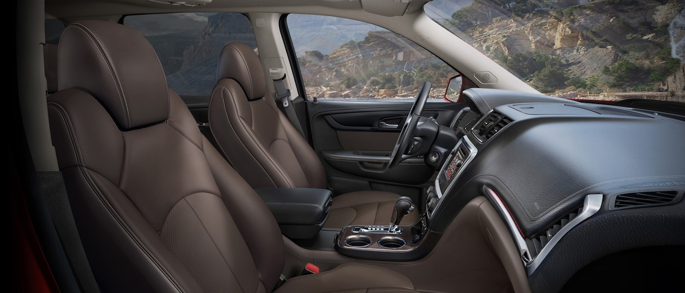 2013 Used GMC Acadia brown mesh seat interior parked next to mountainside