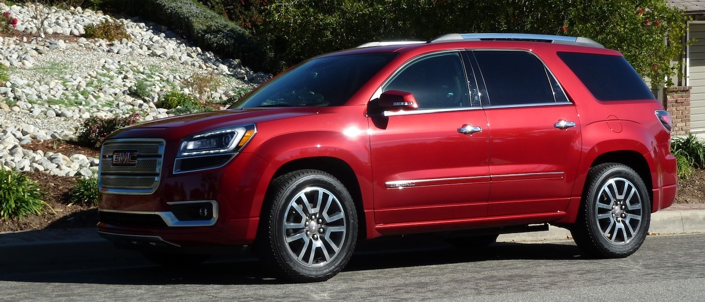 Red 2014 Used GMC Acadia parked in front of rocky hill