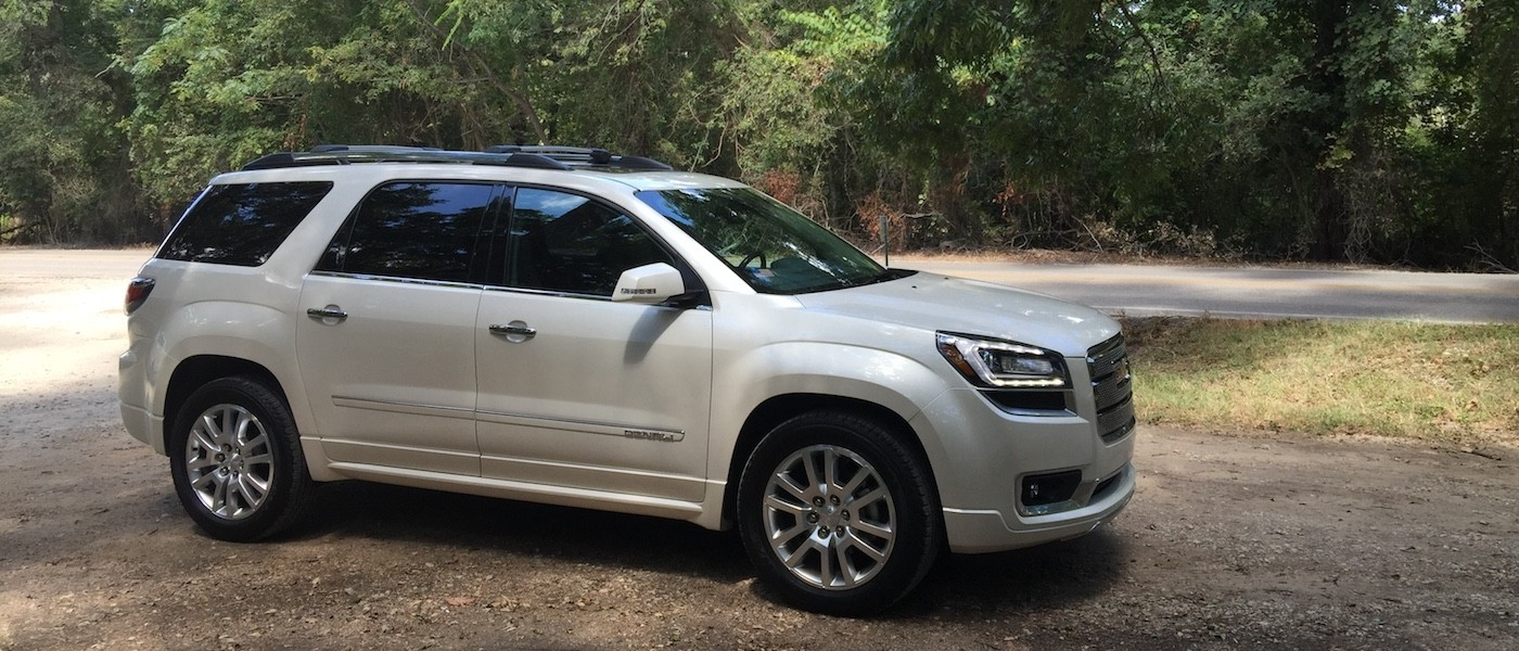White 2015 Used GMC Acadia Denali parked in the woods