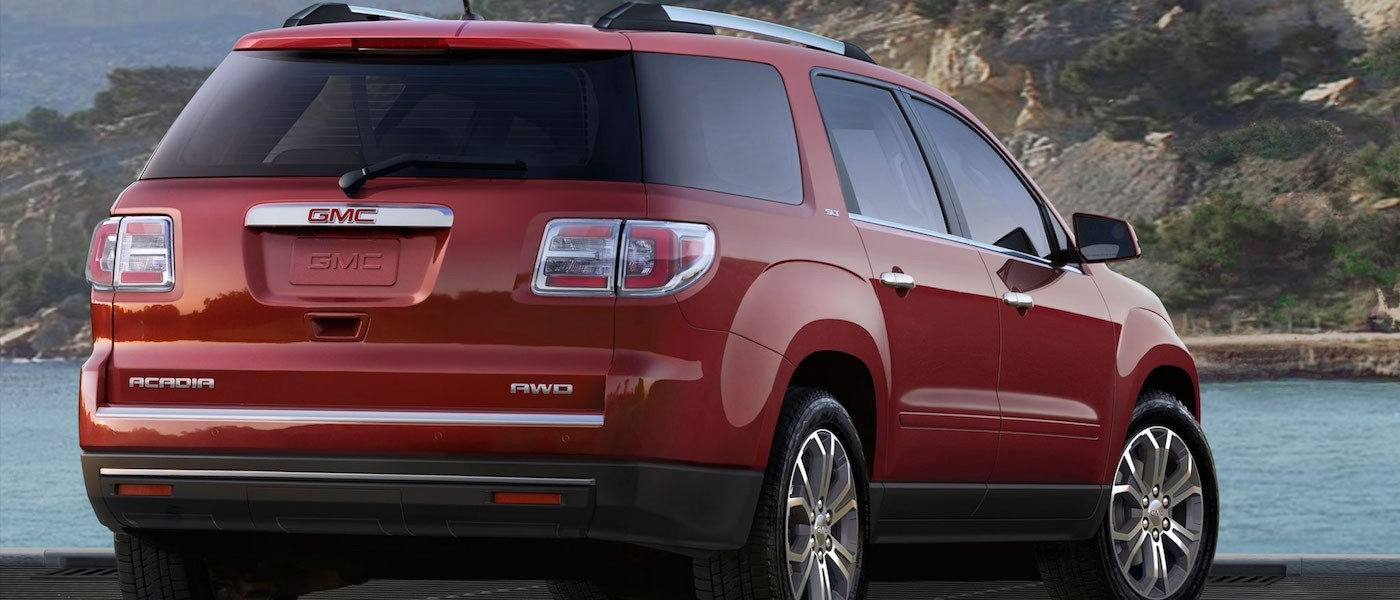Red 2016 Used GMC Acadia SLT from behind in front of water