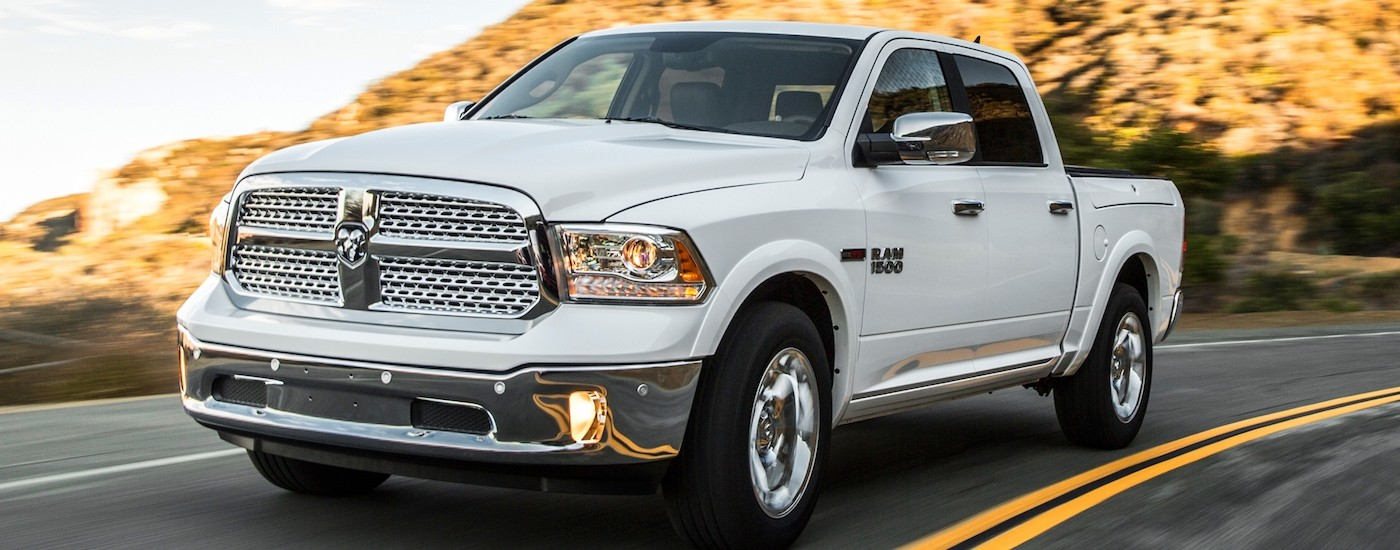 White 2014 Used RAM 1500 driving on a mountain road