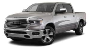 A silver 2019 used Ram 1500 is facing left.