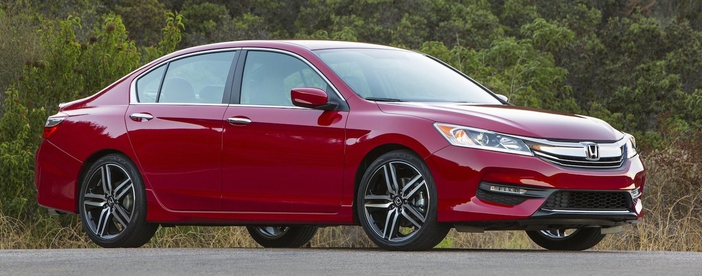 Red 2016 Used Honda Accord parked in front of trees