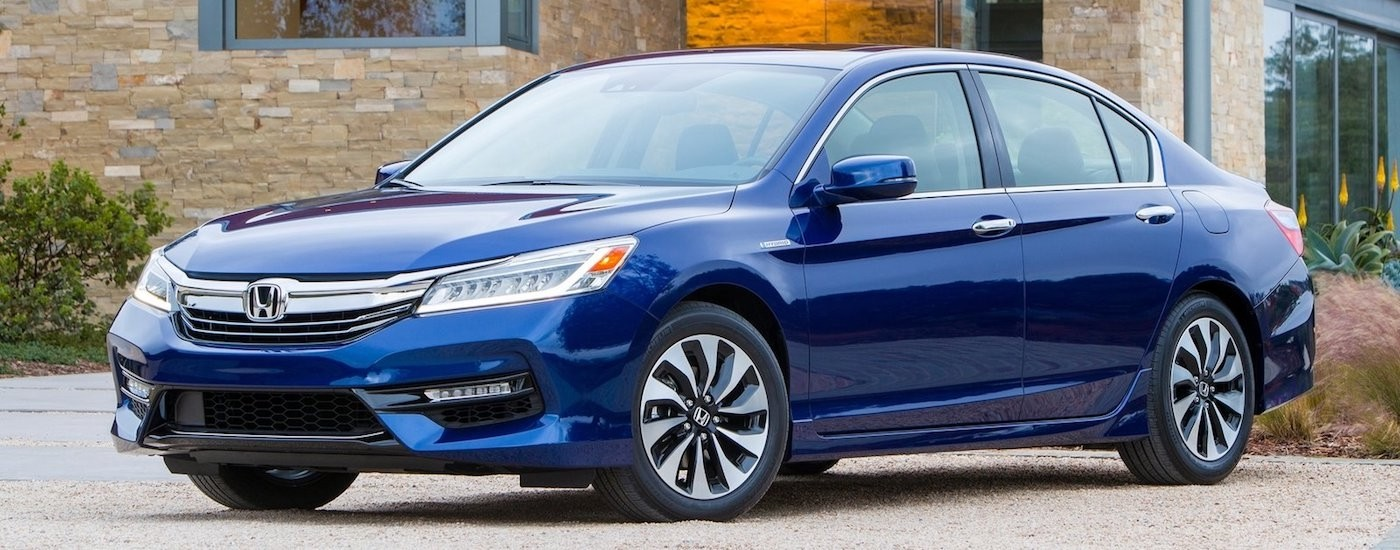 Blue 2017 Used Honda Accord in front of a stone home