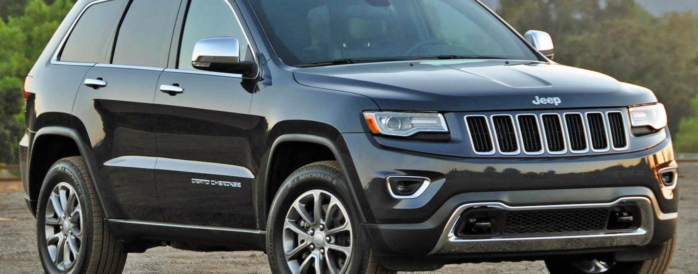 Black 2015 Used Jeep Grand Cherokee angled right parked outside