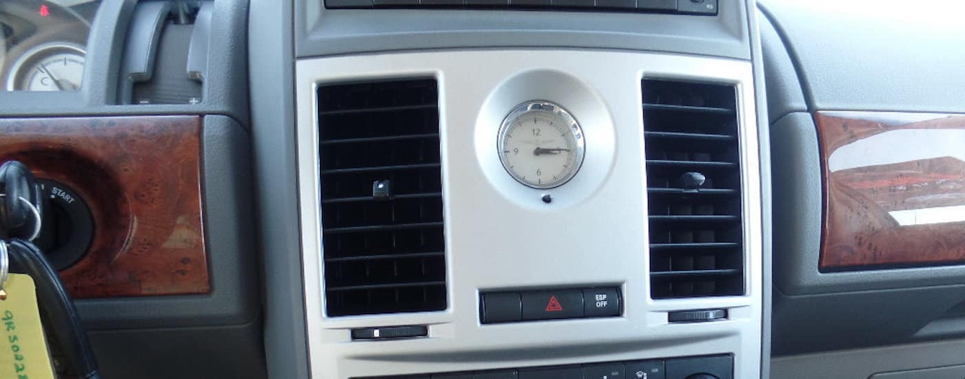 Closeup of 2009 Used Chrysler Town & Country dashboard and analog clock