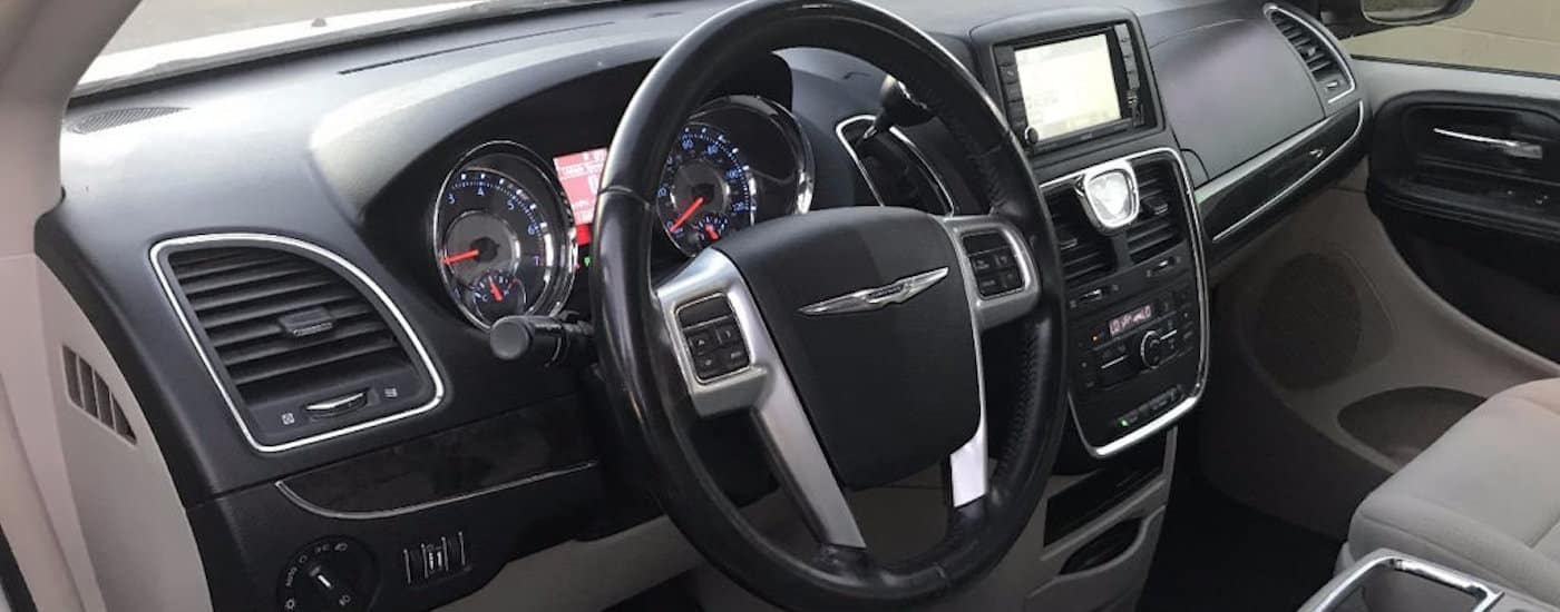 Black and gray 2011 Used Chrysler Town & Country Interior