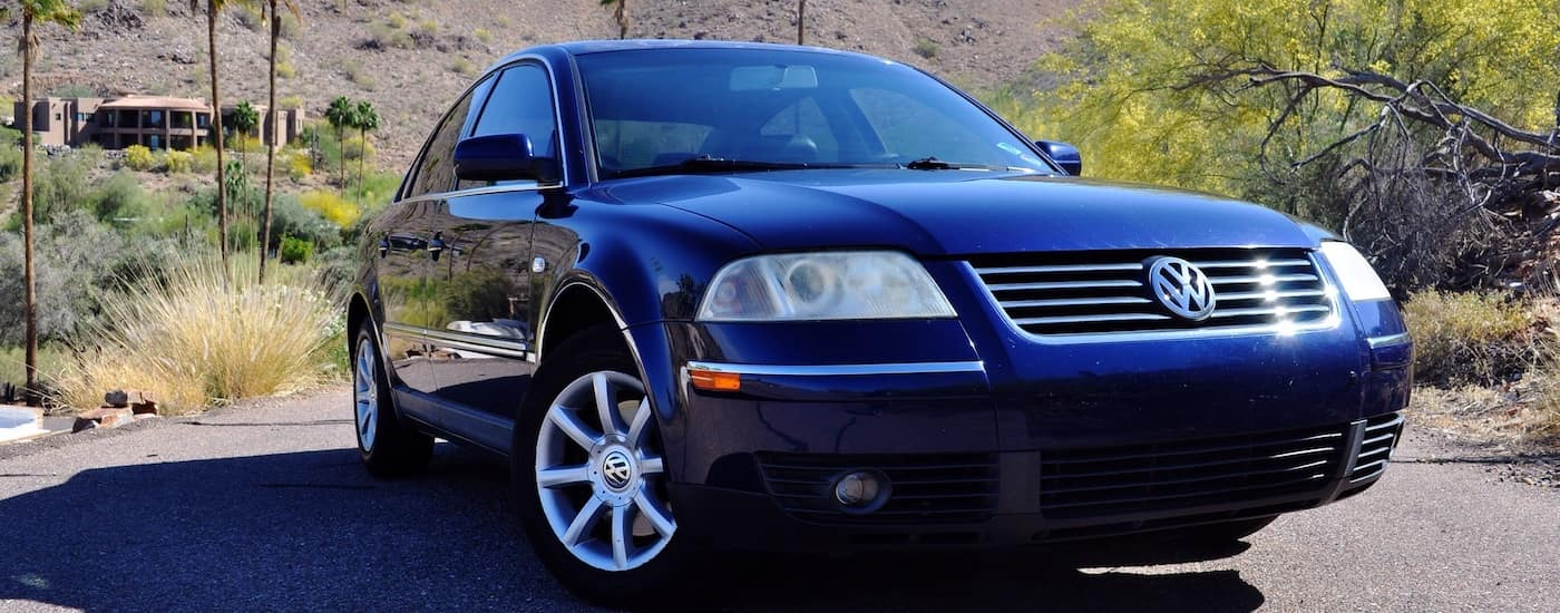 Closeup of the grille of a Blue 2005 Used Volkswagen Passat in the desert