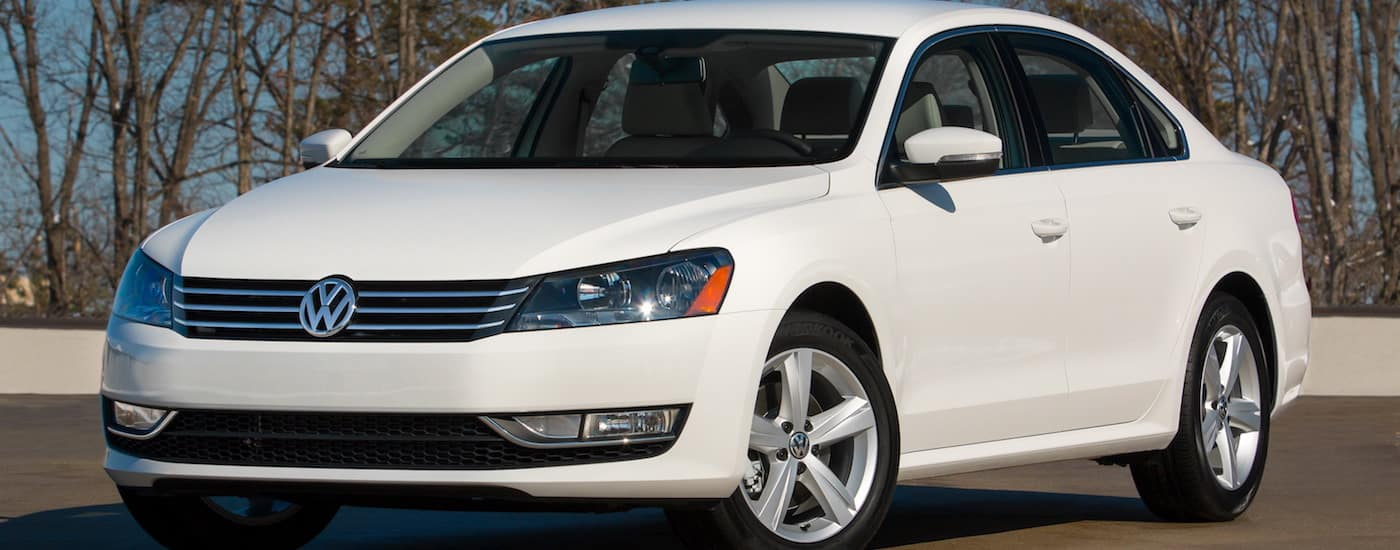White 2015 Used Volkswagen Passat parked in front of trees