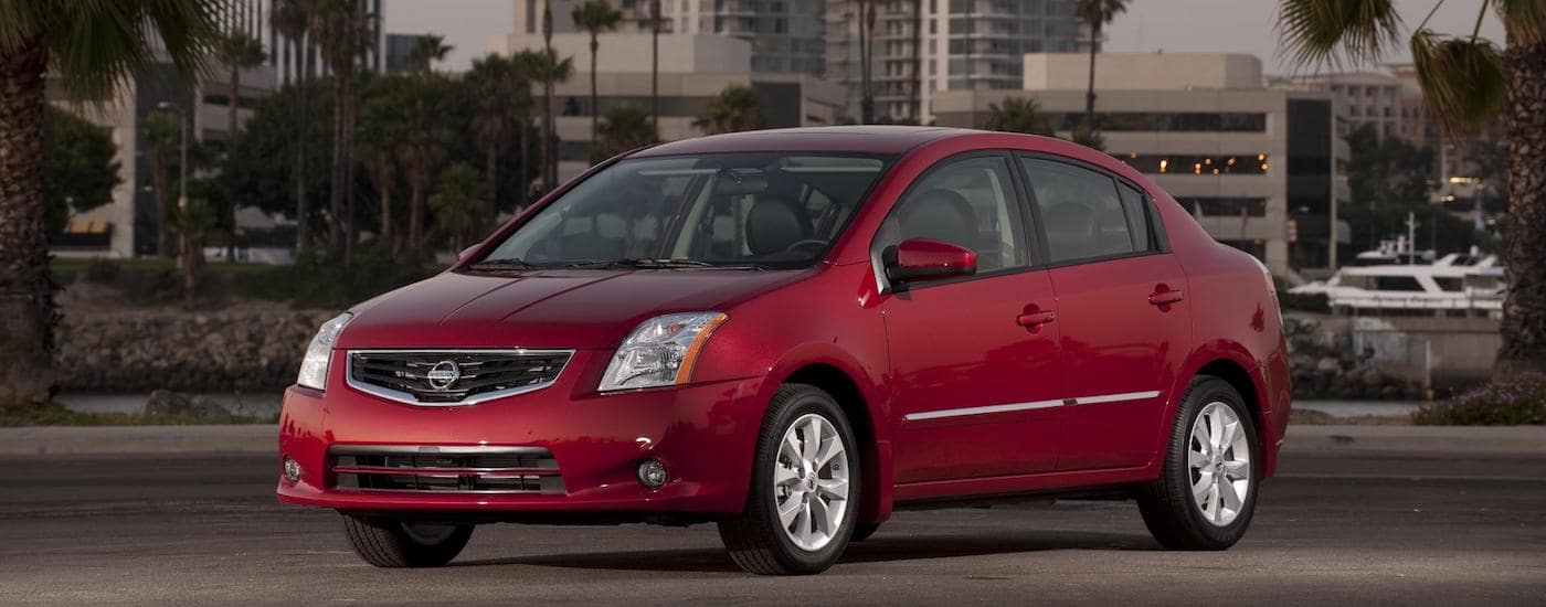 Red 2009 Used Nissan Sentra in the city at dusk
