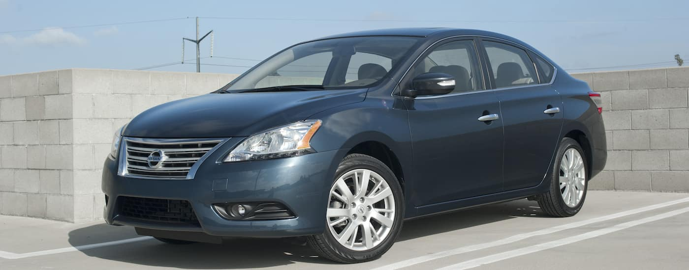Dark blue 2014 Used Nissan Sentra in a concrete parking structure