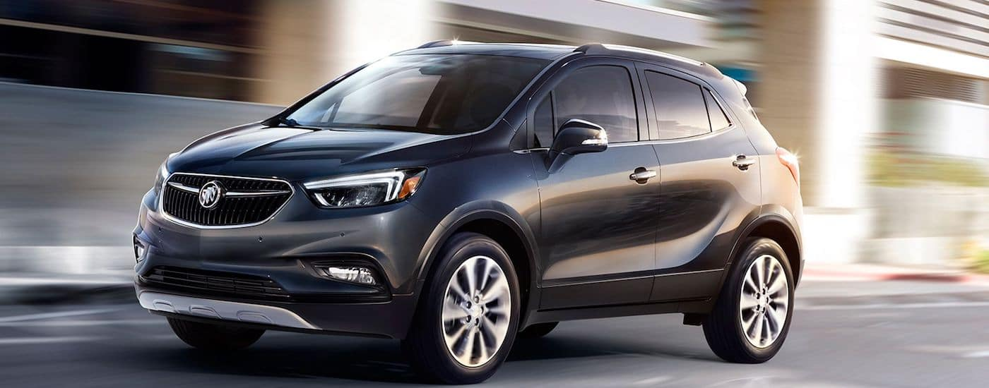 Black Used 2017 Buick Encore driving in the city streets