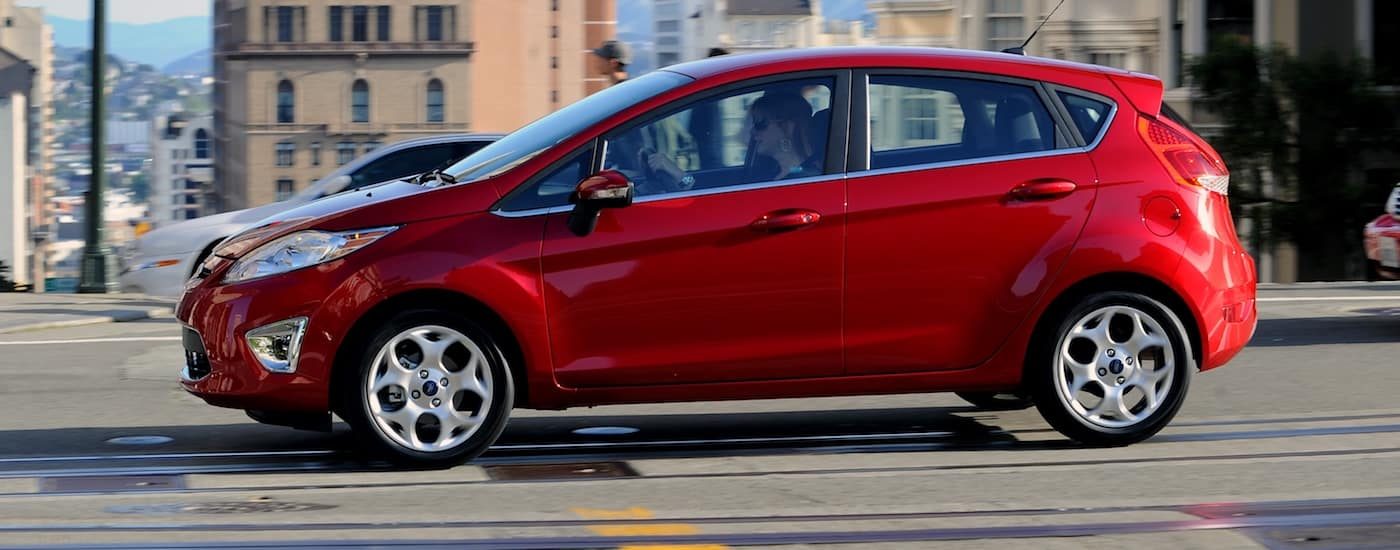 Red 2011 Used Ford Fiesta driving in a city
