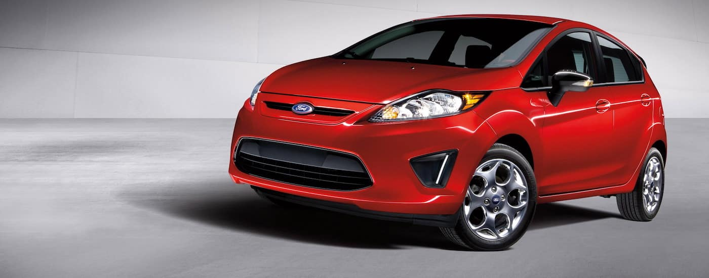 Red 2012 Used Ford Fiesta with gray background
