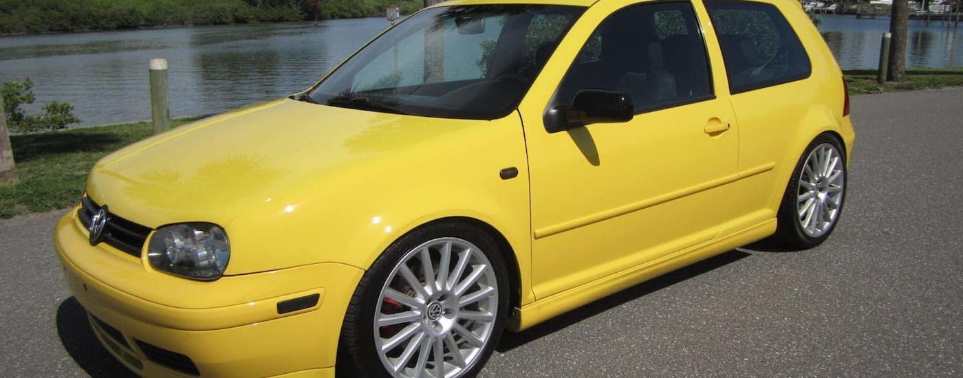 Yellow 2003 Used Volkswagen Golf in front of a lake