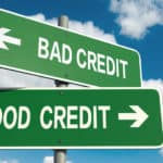 "Two green signs on top of one another, one says ""bad credit"" with arrow pointing left, the other says ""good credit"" with an arrow pointing right"