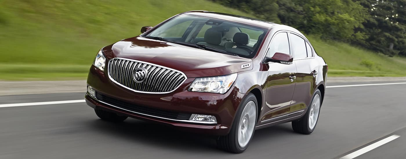 Burgundy 2016 Used Buick LaCrosse driving on grassy road