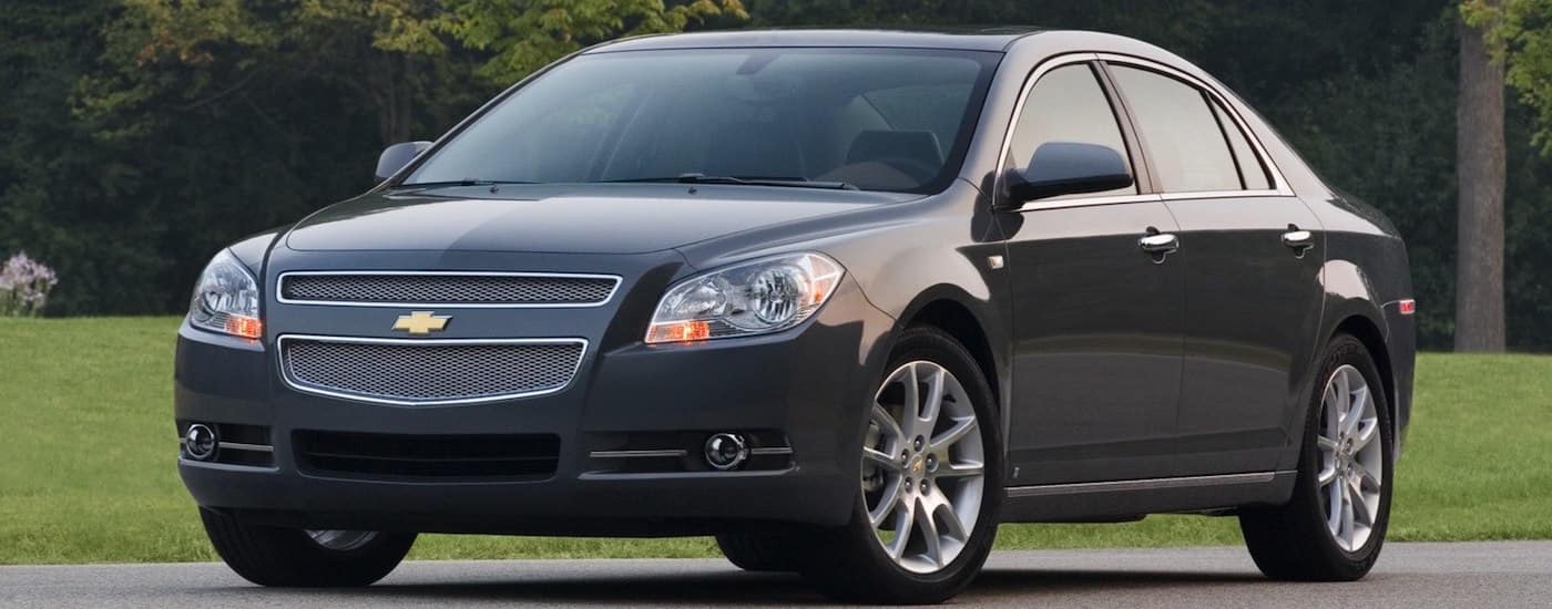 Black 2008 Used Chevy Malibu in front of a park