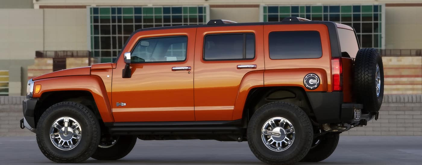 Orange 2008 Used Hummer H3 profile in front of building