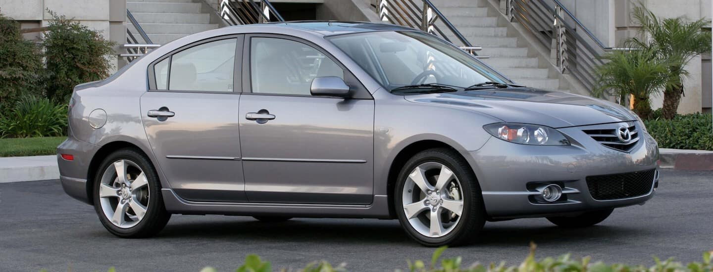 Silver 2003 Used Mazda3 in front of stairs