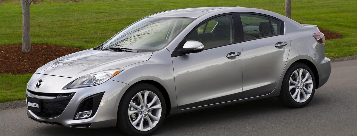 Silver 2009 Used Mazda3 in front of a grassy park