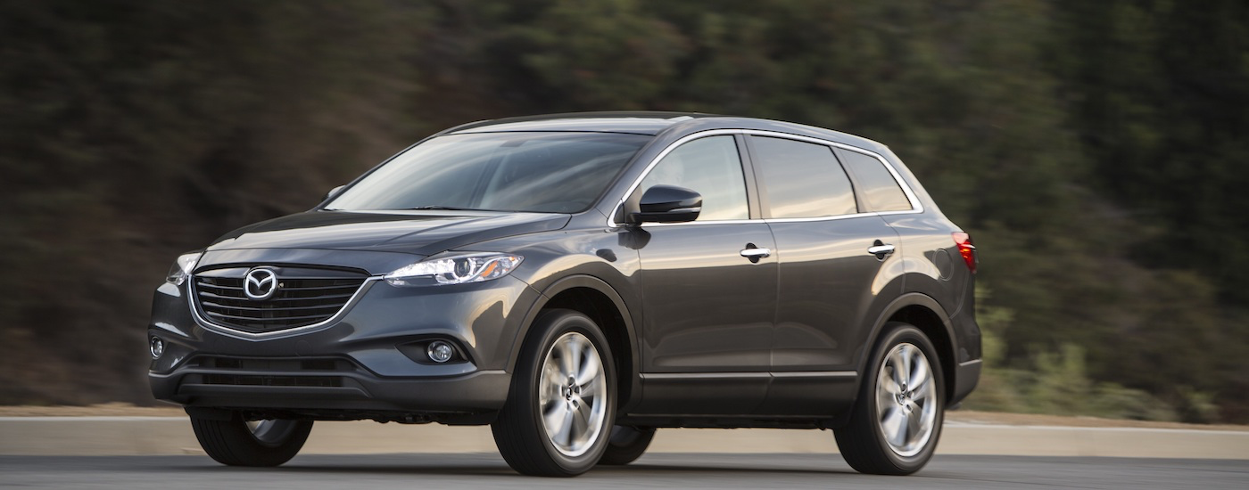 Gray 2015 Used Mazda CX-9 driving on rural road