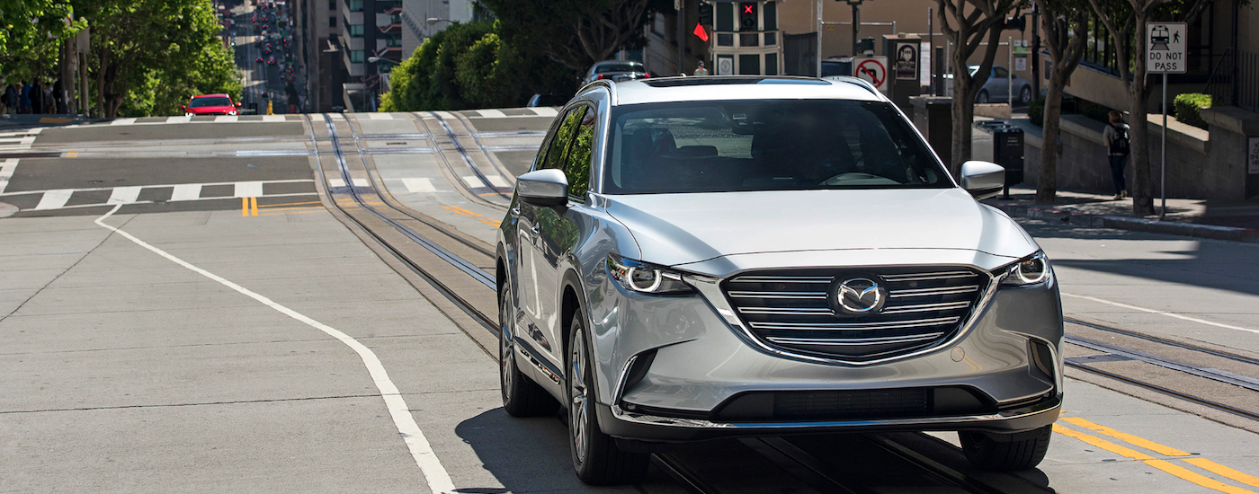Silver 2018 Used Mazda CX-9 on city street from front