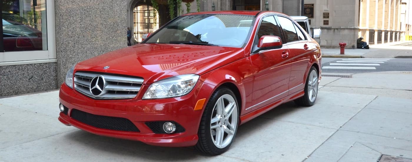 Red 2008 Used Mercedes C-Class on a city street