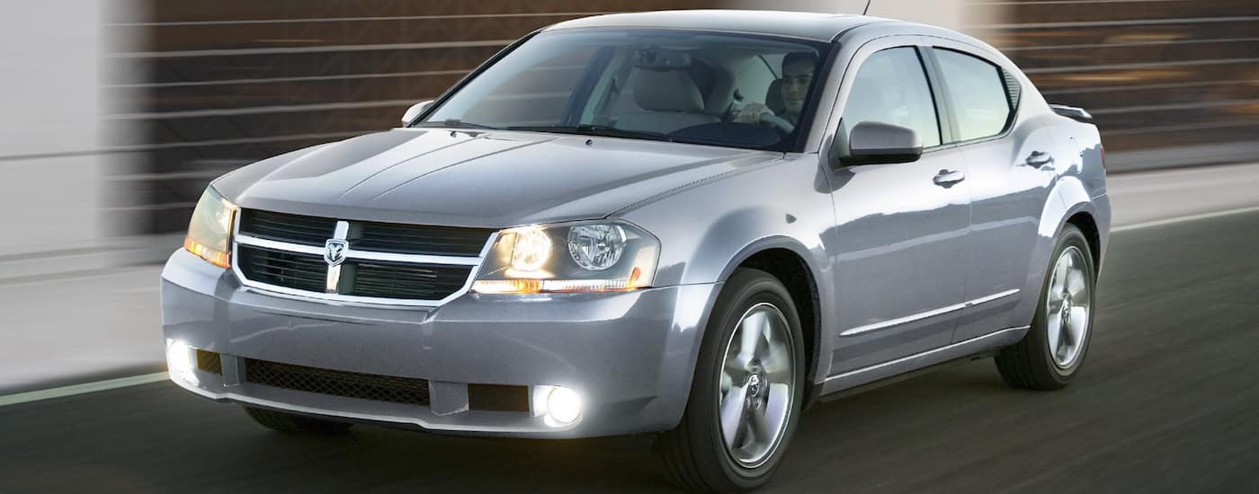 Silver 2010 Used Dodge Avenger R/T racing down a street