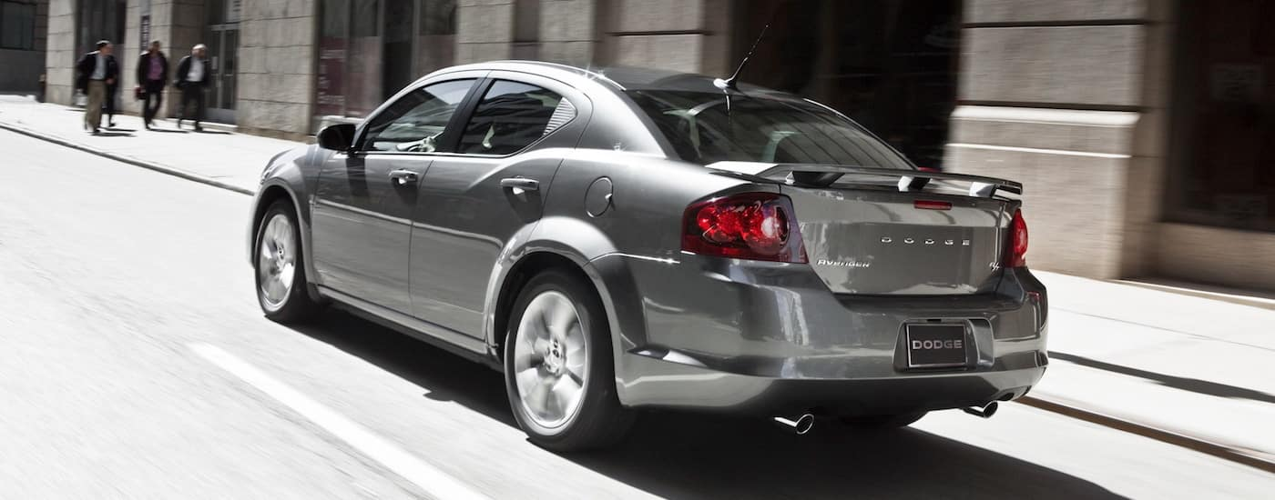 Silver 2012 Used Dodge Avenger R/T racing down a city street