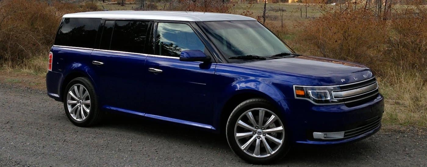 Dark Blue 2014 Used Ford Flex in front of a field with large bushes