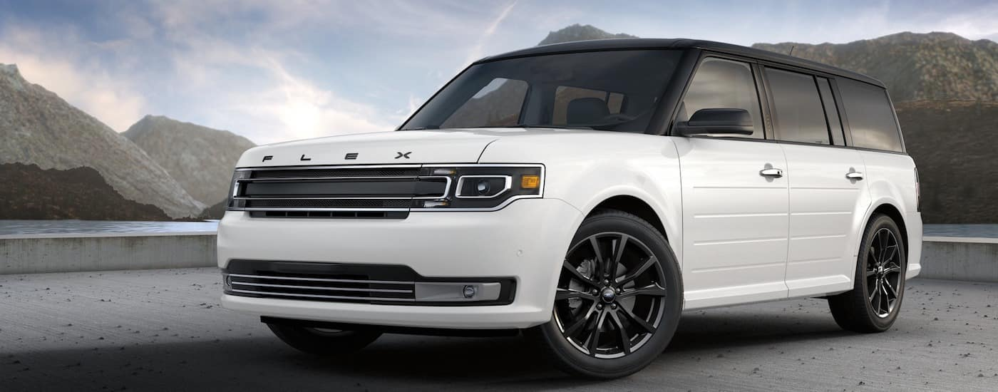 White 2017 Used Ford Flex against blue sky and mountains