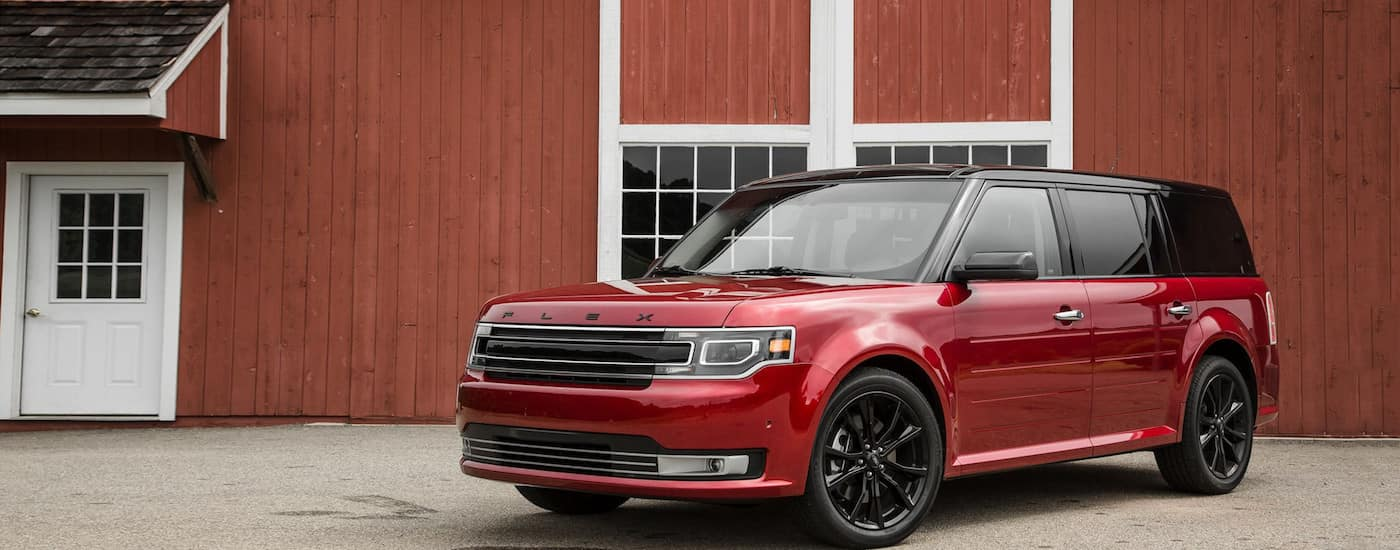Red 2018 Used Ford Flex in front of a red barn