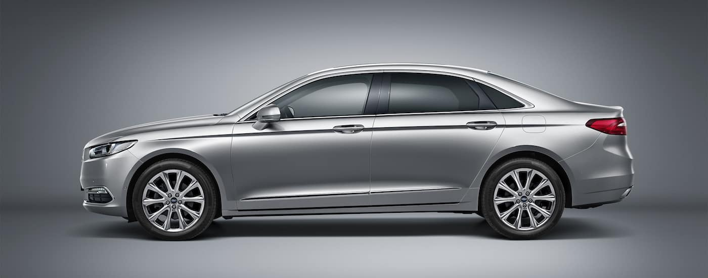 Silver 2016 Used Ford Taurus profile on gray