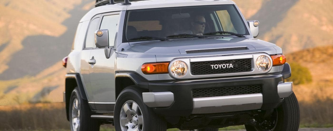 Silver 2008 Used Toyota FJ Cruiser with mountains in the distance