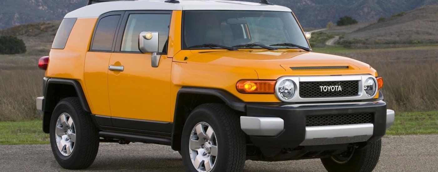 Yellow 2009 Used Toyota FJ Cruiser in a field